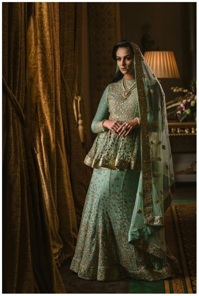 Photo of sea blue and gold embellished bridal lehenga
