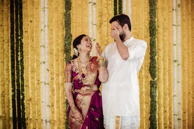 Photo of A shot of a couple laughing at their wedding function