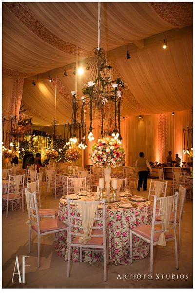 Photo of Floral Themed Table Decor Settings