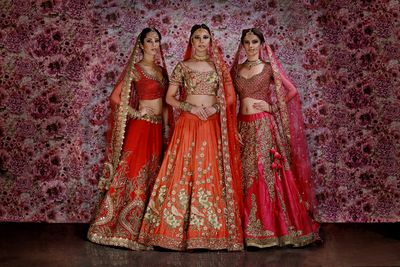 Photo of Red bridal lehengas on models