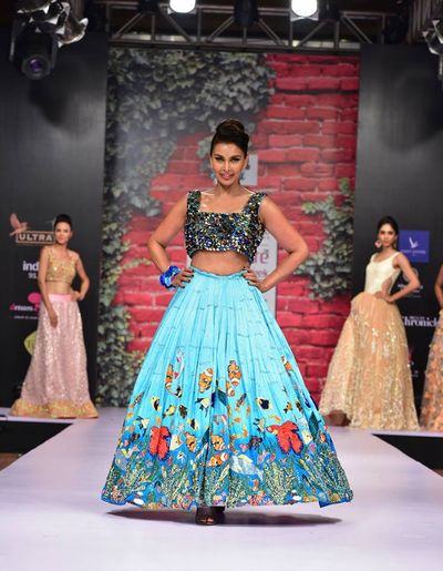 Photo of Fun aqua lehenga with floral prints for mehendi