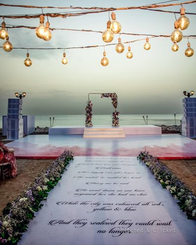 Photo of personalised mandap decor with a printed aisle and stage setup