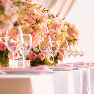 Photo of Table settings done with pastel hued flowers