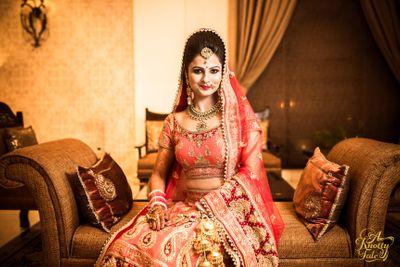 Photo of orange and red bridal lehenga