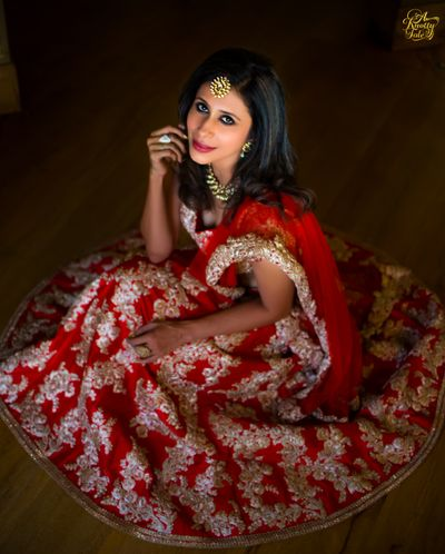 Photo of red and gold engagement lehenga
