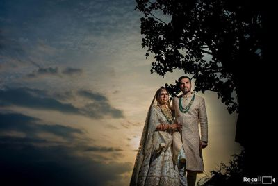Photo of wedding day couple sunset shot with both wearing matching outfits