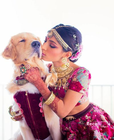 Photo of cute bridal shot with her kissing the dog