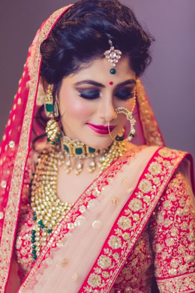 Photo of Bold bridal makeup with smokey eyes