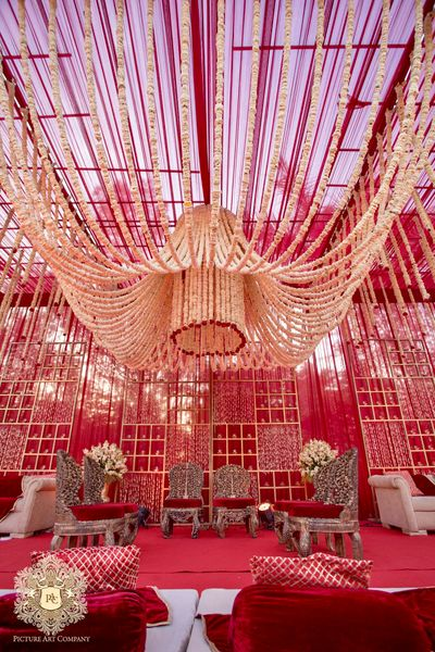 Photo of Mandap with floral chandelier