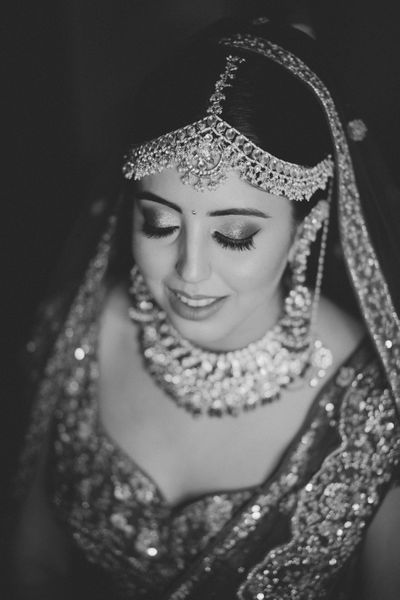 Photo of Black and white bridal portrait with eyes closed