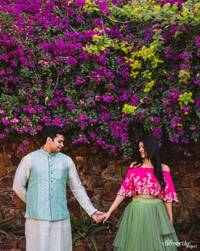 Photo of Mehendi couple portrait in bright outfits