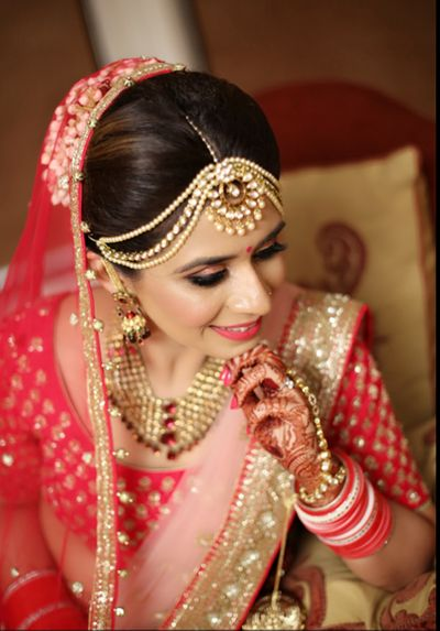 Photo of Gold and pearl bridal mathapatti