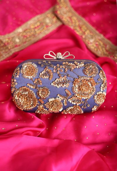 Photo of A blue clutch bag with sequined details.