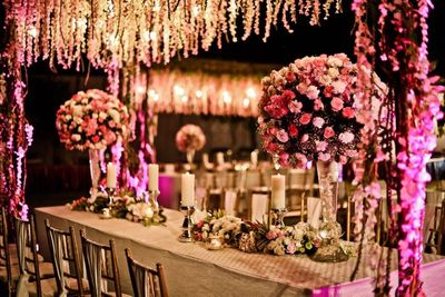 Photo of Light pink and white theme floral table decor