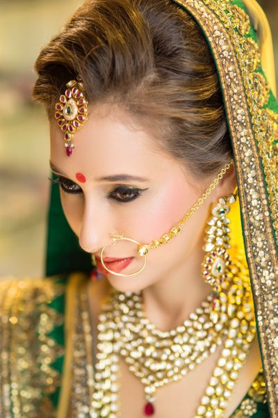 Photo of Subtle Bridal Makeup with Kitten Flick and Brown Lips