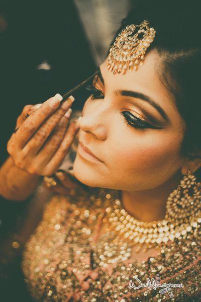 Photo of Golden bronze makeup for Indian bride