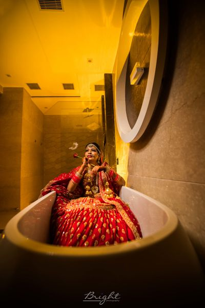 Photo of Bride chilling in bathtub shot before wedding