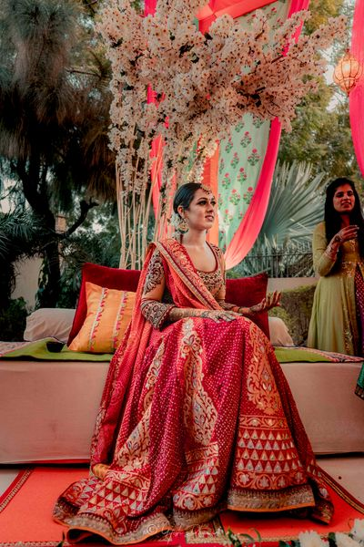 Photo of A bride in a red lehenga for her mehndi