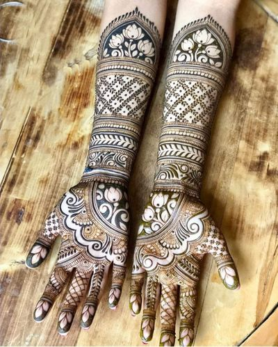 Photo of Beautiful inticate bridal mehndi design for full hands