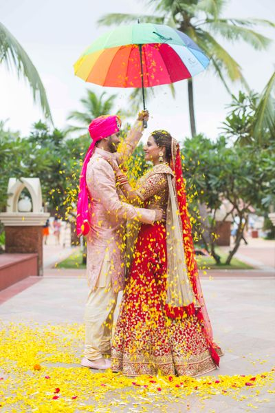 Photo of Couple Portrait with Umbrella and Petals