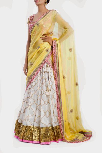 Photo of white yellow and pink lehenga