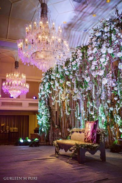 Photo of Floral Backdrops with Crystal Chandelier