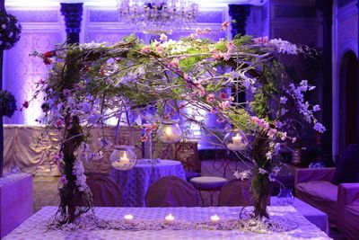 Photo of Lavender and green table centerpiece