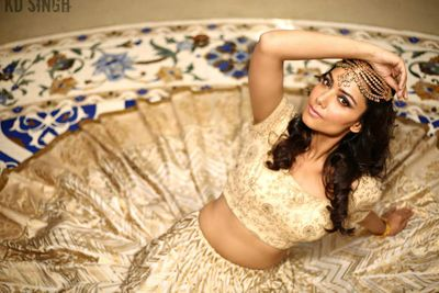 Photo of Gold Lehenga with Blue Floral Border