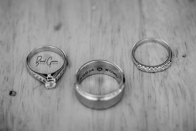 Photo of Black and White Portrait of Etched Engagement Rings