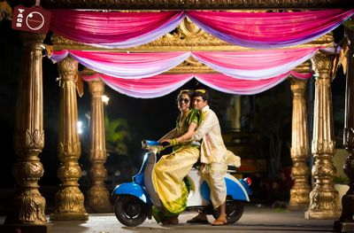 Photo of South indian wedding couple on vespa