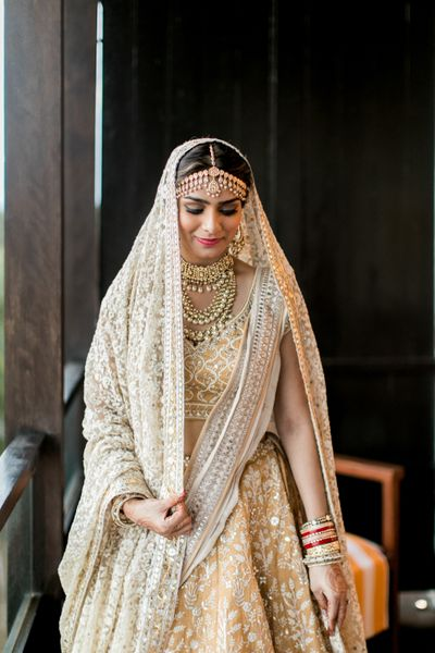 Photo of Bride in white lehenga