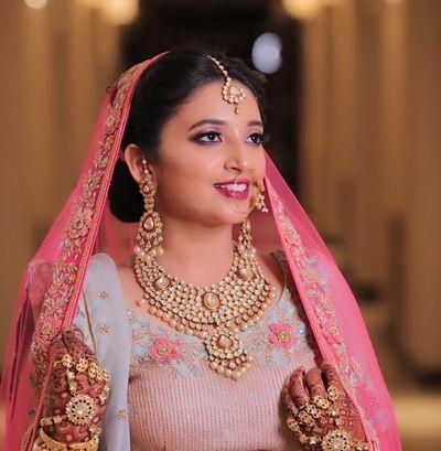 Bride Sakshi in a Pastel blue lehenga