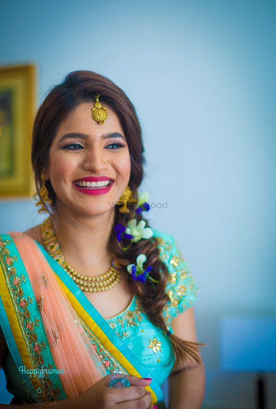 Photo of Smiling bride to be on mehendi day
