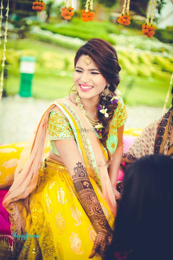 Photo of Candid bride to be shot on mehendi day
