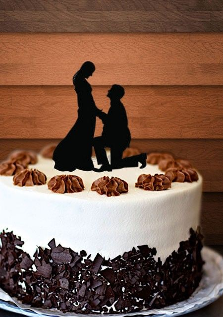 Photo of Cake with proposal topper