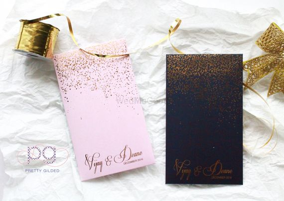 Photo of Light Pink and Black Wedding Cards with Sparkle Dust