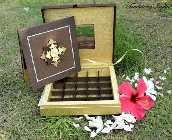 Photo of gold and brown invitation card box