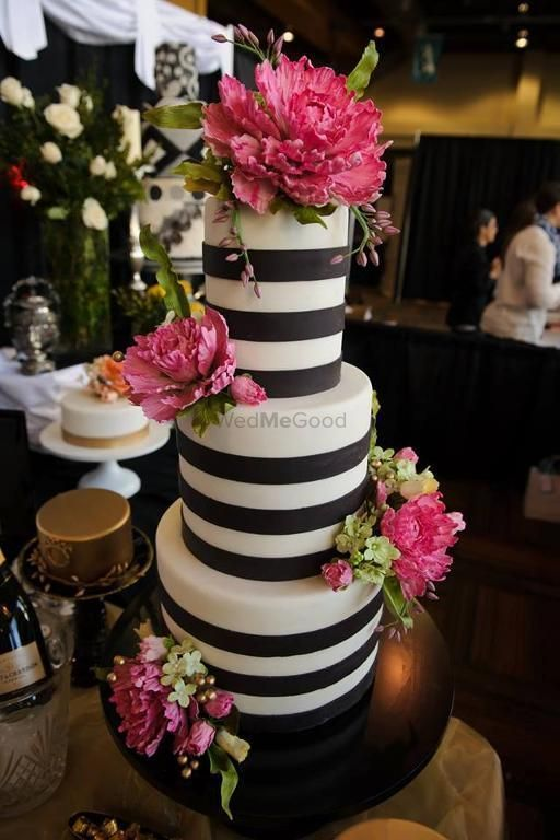 Photo of Black and white striped cake with pink flowers