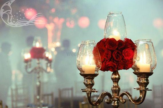Photo of Silver Lantern Candelabras ans Roses as Table Decor