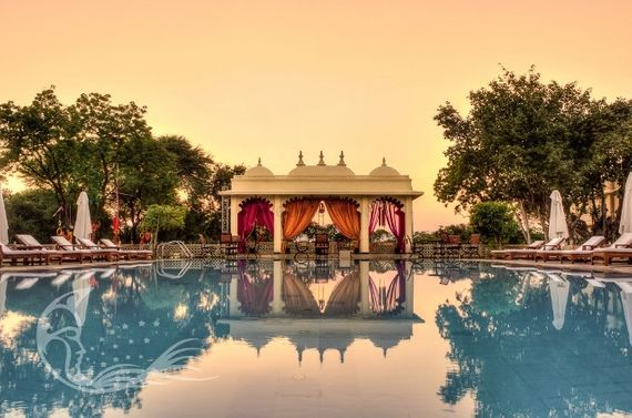 Photo of Poolside mandap decor in pink and yellow