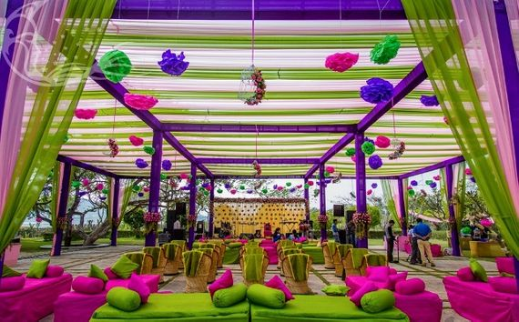 Photo of Colourful mehendi decor with hanging paper lamps