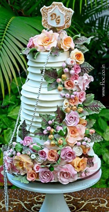 Photo of mint wedding cake with ruffles and layers