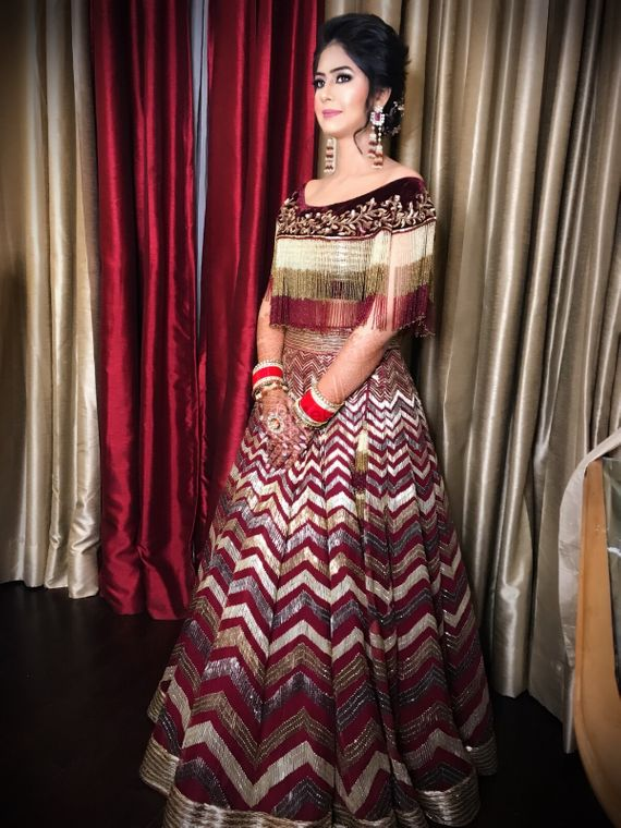 Photo of Pretty tassel blouse with maroon lehenga for reception