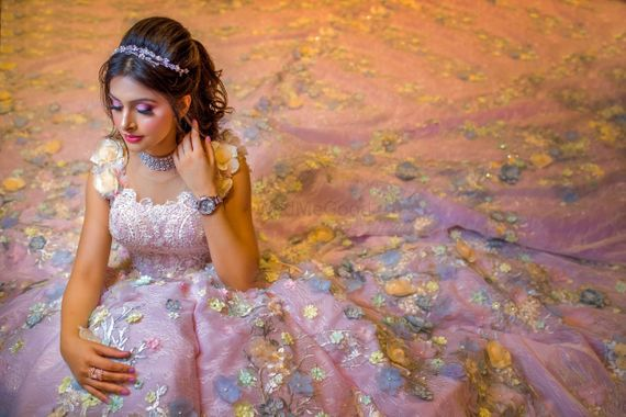 Photo of A bride in a glittering lavender gown with sequins.