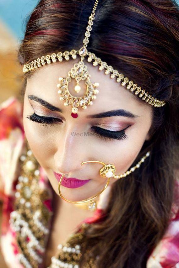 Photo of pink glitter eye bridal makeup