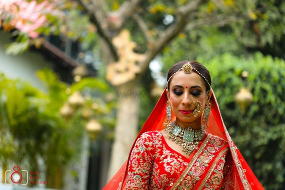 Photo of Unique blue choker necklace with red bridal lehenga