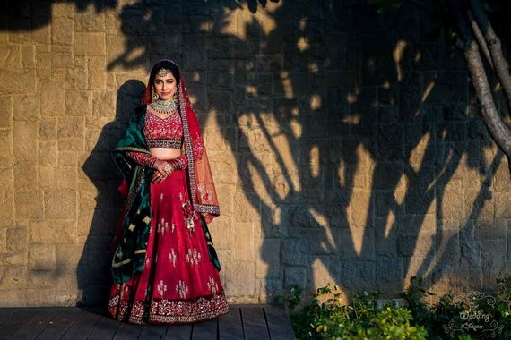 Photo of A bride in red lehenga