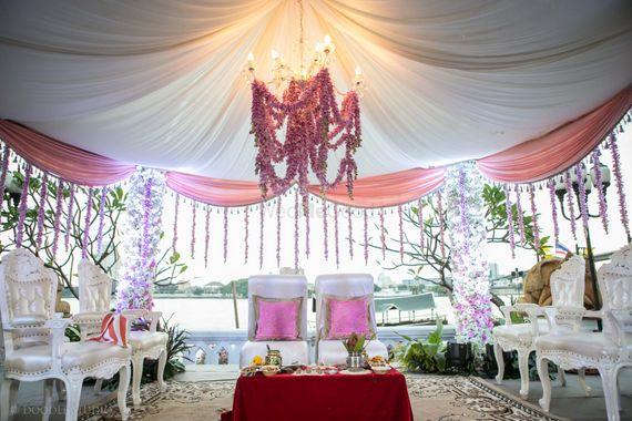 Photo of Bride and groom seat in Mandap