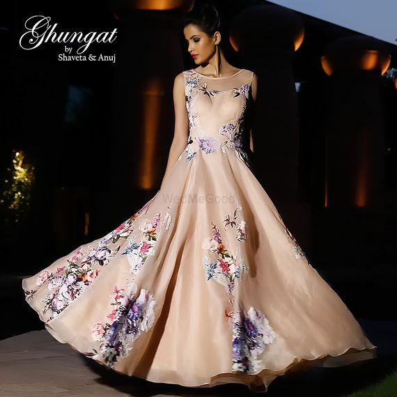 Photo of Light peach gown with floral prints