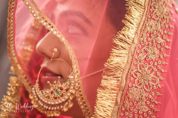 Photo of Oversized bridal Nath in gold